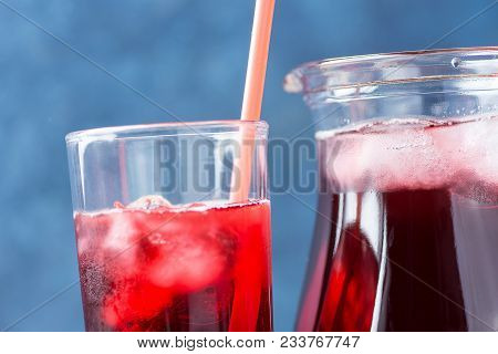 Healthy Refreshing Drink From Ice Hibiscus Tea And Red Berries And Fruits Juice In Pitcher And Tall