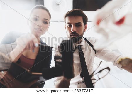 Private Detective Agency. Man With Holster And Woman Are Looking At Gun With Magnifying Glass.