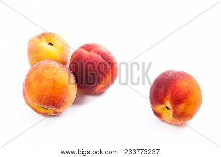 Group Of Ripe Peach Fruit Isolated On White Background.