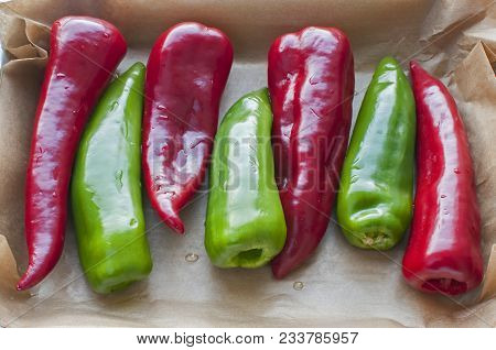 Fresh Organic Red And Green Peppers Cleaned, Deseeded And Prepared For Stuffing