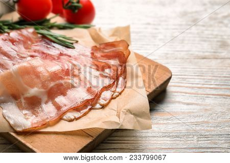 Board With Raw Bacon Rashers On Wooden Background