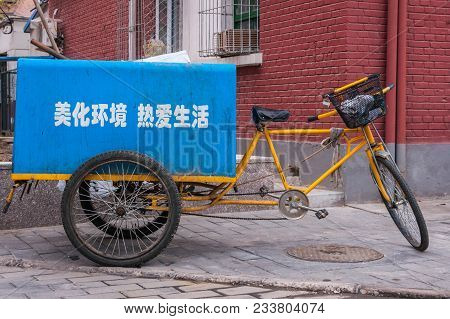Beijing, China - April 26, 2010: Closeup Of Yellow Trash Collection Tricycle With Blue Garbage Bin M