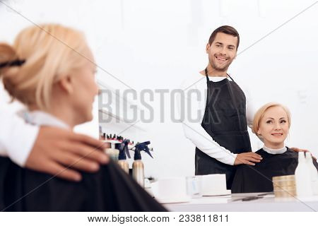 Hairdresser Chooses Haircut For Mature Attractive Woman In Beauty Salon. Mature Woman In Beauty Salo