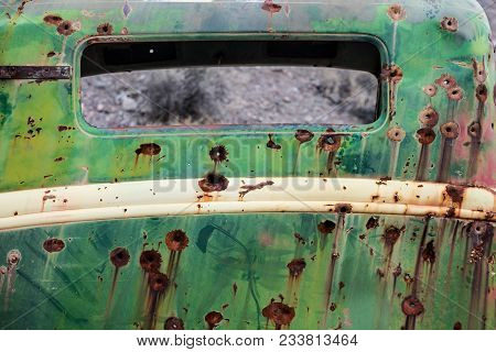 Rusty Old Car Metal With Bullet Holes