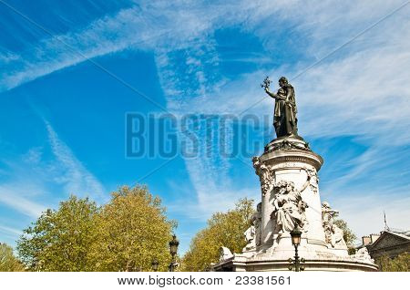 The Famous Statue of the Republic in Paris looking away in the blue sky. built in 1880 in the center of the place of the Republic. It symbolizes the victory of the Republic in France
