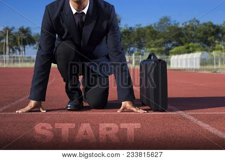 A Businessman On A Track Ready For Race In Business