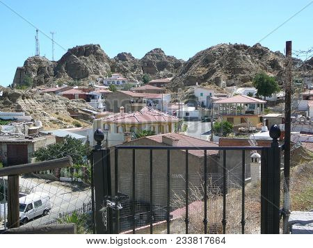Group Of Houses Nestling In Hills Near Guadix In Granada Province, Andalusia Spain