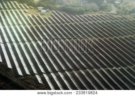 A Large Area Occupied By Solar Panels At The Airport. Solar Panels Face Sunlight On Green Field. Sol