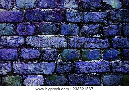 Deep Blue Brick Wall Background Faded On Black. Brick Wall Painted In Bright Colors. Blue Bricks In