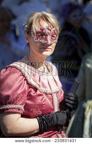 Abano, Italy. May 10, 2015: Carnival-style Mask Festival With Costumes And Masked Figures Parading I