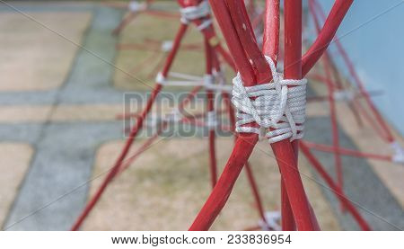 Rope And Wood Forming The Tripod