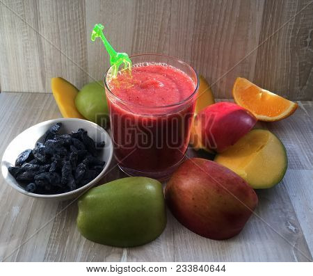 Useful Fruit Drink Smoothies In A Glass Cup, Whipped Apple Mango Orange And Stocks From The Summer,