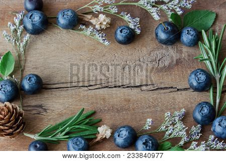 Beautiful Vintage Background Or Wallpaper Frame Of Fresh Wild Blueberries On Wood Plank. Blueberry B