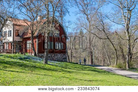 Unrecognizable People Enjoying A Walk And Spring Atmosphere In The City Park Along Motala River In N