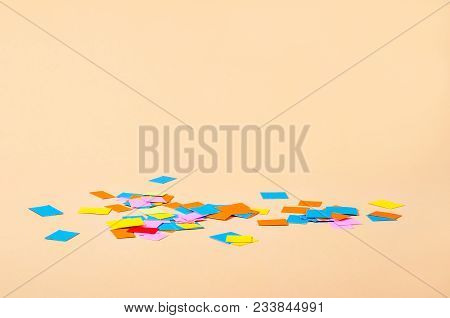 Colorful Scrap Paper Scattered On A Yellow Background With Blank Space For Your Text Or Message.
