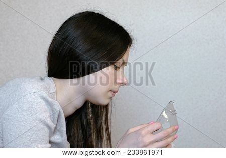 Use Nebulizer And Inhaler For The Treatment. Young Woman Prepare Inhaling Through Inhaler Mask. Clos