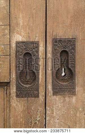 Rustic Door Locks - Old Skeleton Key Locks On An Old Wooden Gate.