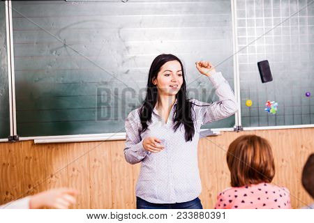 The Teacher Explains The New Material On The Lesson For Pupils And Cute Pupils Are Listening Their T
