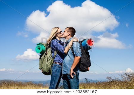 Romantic Young Couple Kissing While Traveling In The Mountains