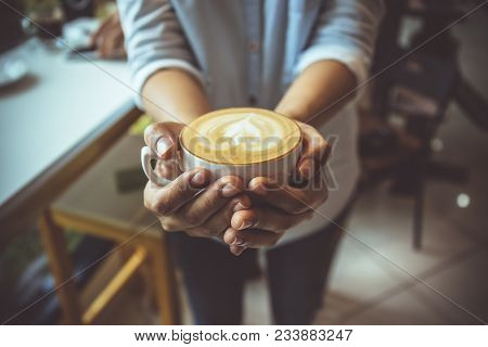 Woman Hand Holding Coffe Cup In Coffee Shop