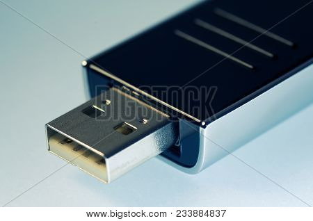 Close-up Of Usb Flash Memory Drive Connector On White Background