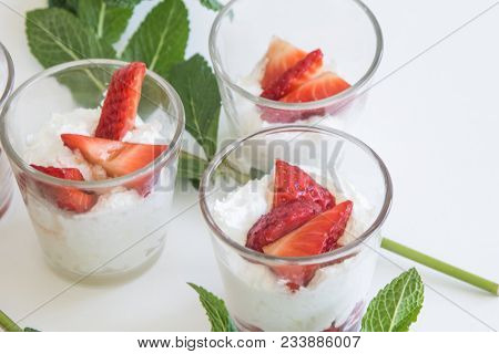 Seasonal Strawberries With Cream And Mint In Glass Cup