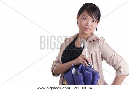 Stylish Asian Woman With Umbrella