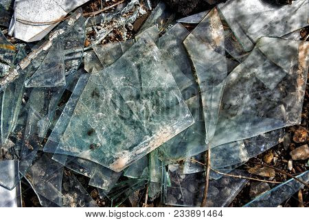 Many Broken Pieces Of Glass. Shattered And Splitted Glass Pieces. Glass Texture. Abstract Background