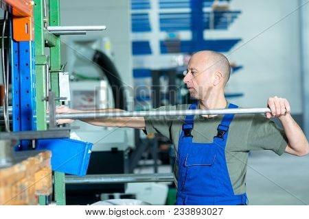 One Worker Working In Factory In Stockroom