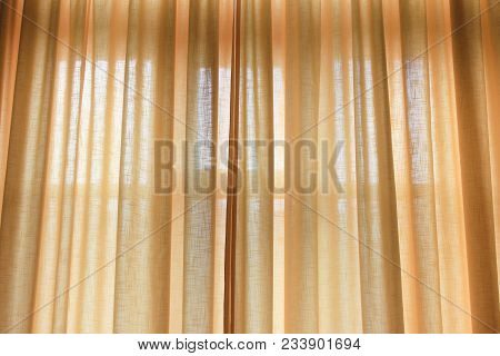 Curtains Drawn Of Light Soft Yellow Pastel Color. Elegant Curtain Cloth On Bedroom Or Living Room Wi