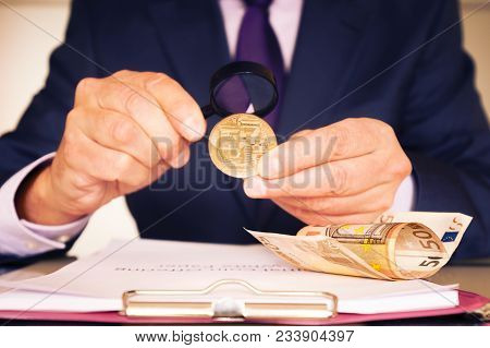 The Investor Decides On Investing In The Ico. On The Desk There Is A White Paper Initial Coin Offeri