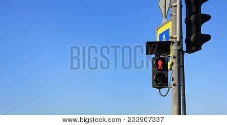 Red Traffic Light On Blue Sky Empty Background. City Street Pedestrian Crosswalk Stop Signal Showing