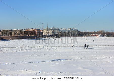 Ice Frozen Neva River And St. Petersburg City Skyline In Russia. Winter Scene Cityscape View Of Snow