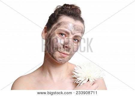 Young Beautiful Girl With Black Mask For Face Isolated On White Background. Skin Care. Purification