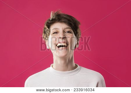 Front View Of Extremely Happy And Laughing Young Girl. Cute Stylish Model With Shot Haircut On Trand