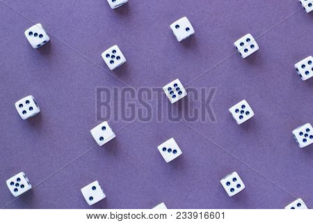 Gaming White Dice Pattern On Purple Background In Flat Lay Style. Concept With Copy Space For Games,