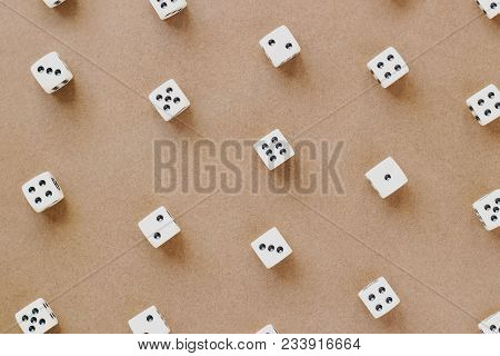 Gaming White Dice Pattern On Brown Background In Flat Lay Style. Concept With Copy Space For Games,
