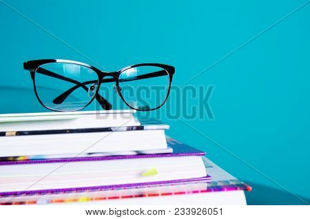 Glasses On A Stack Of Book S In The Interior In A Minimalist Style. Monocolor. The Concept Of Readin