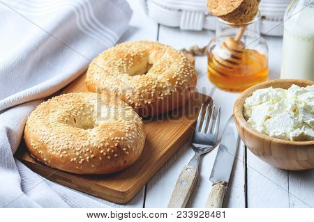 Bagel With Cottage Cheese , Banana And Honey. Concept Of Healthy Breakfast. White Wooden Background