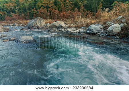 Beautiful Reshi River Water Flowing Through Stones And Rocks At Dawn, Sikkim, India. Reshi Is One Of