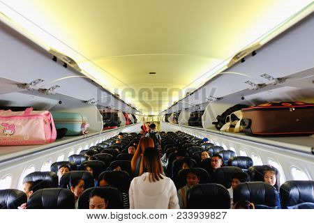 Airplane Chiang Rai, Thailand- December 11, 2017 : Interior Of Air Asia Airplane With Passengers Sit