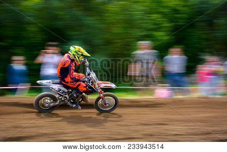 Uzhgorod, Ukraine - May 21, 2017: Junior Mx Rider Turns On A Corner. Motion Blur With Flying Dirt. T