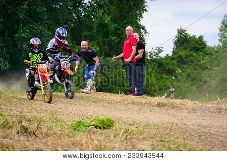 Uzhgorod, Ukraine - May 21, 2017: Extreme Enduro Moto Sport Junior Riders In The Action. Parents Sho