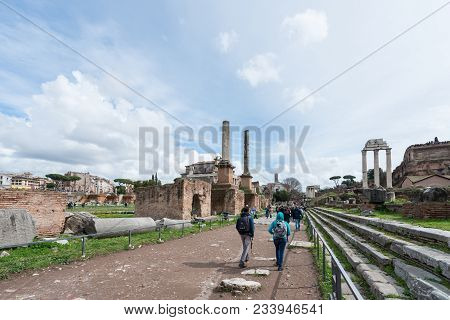 Rome, Italy, March 07, 2018: Horizontal Picture Of Tourists Walking In The Old Street Of The Ancient