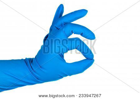 Hand Gesture Ok In A Rubber Glove Of Blue Color, Closeup