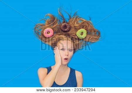 Young Woman With Donuts In Her Hair. Multicolored Donuts. Harm Of Sweet.