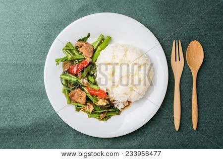 Thai Food, Stir Fried Morning Glory (pad Pak Boong) With Cooked Rice On Dish, Glass Of Milk And Piec