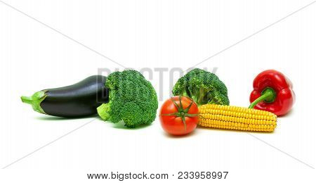 Broccoli And Other Vegetables On A White Background. Horizontal Photo.