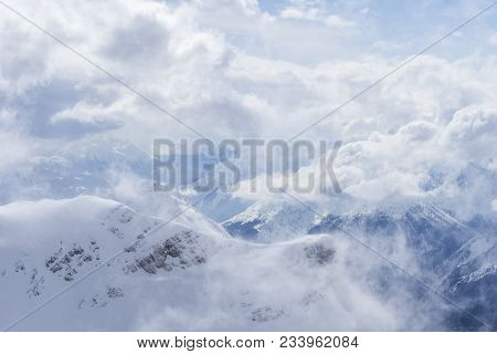 Close-up Of Amazing Snowy Mountains Surrounded By White Clouds In The Bavarian Alps.  View To Beauti