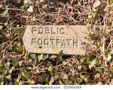 Public Footpath Sign Post Stone In Hedgerow Direction Pointer